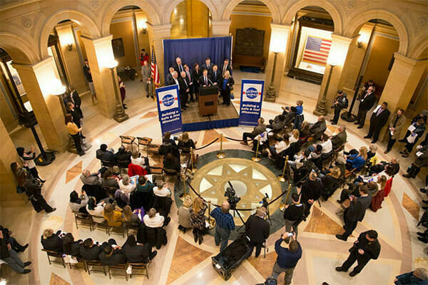 Second Chance Day in the Minnesota State Capitol rotunda, from above. Speaking is Secretary of State, Steve Simon.