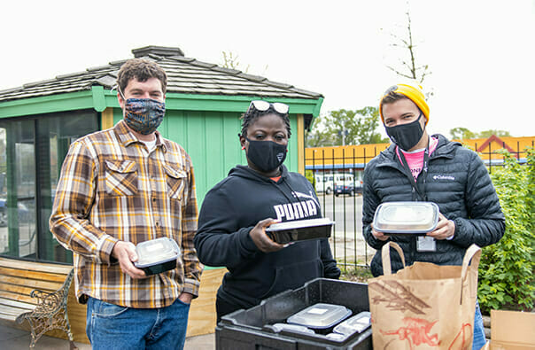 Avivo staff get ready to distribute meals in this image captured by Second Harvest Heartland staff.